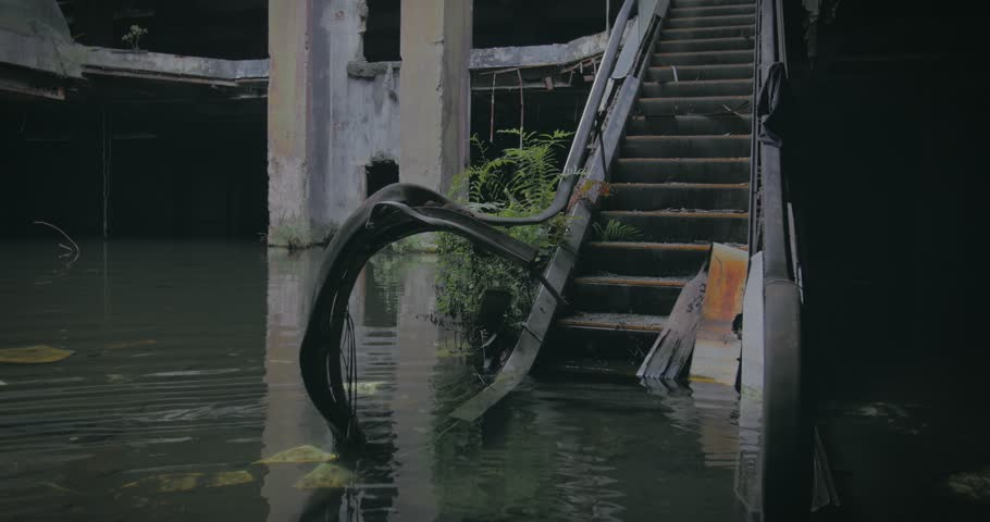 Doomsday concept background after civilization dead caused by wars and disasters. End of the world video of broken escalator in abandoned and flooded building