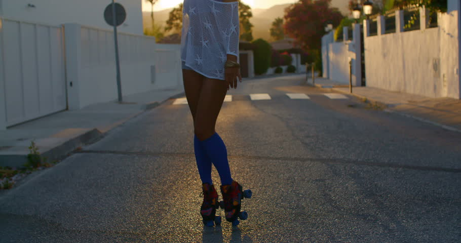Sexy Roller Skate Girl Dancing on the Street at Sunset Rays on Slow Motion Video | Shutterstock HD Video #10608653
