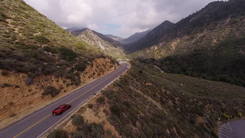 Extreme ride on the red Lamborghini Gallardo at Angeles Crest Hwy. Shooting from a helicopter. | Shutterstock HD Video #10628435