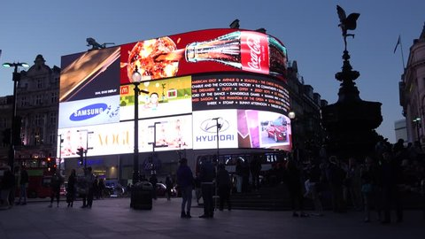 LONDON - ENGLAND, JUNE 5, 2015, 4K Piccadilly Circus at twilight with tourist people enjoy video display
