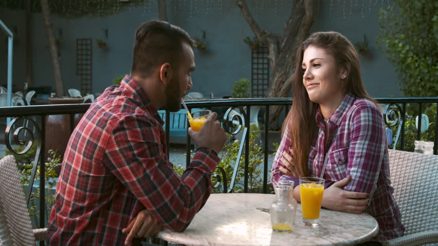 4k wide video of young multiracial happy and romantic couple chatting on date in cafe.  | Shutterstock HD Video #10633484