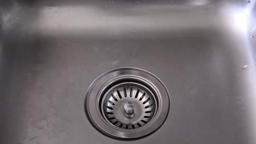 hand closes the drain stopper from sink and water faucet running hd stock footage - Kitchen Sink Drain