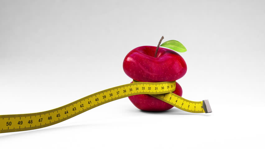 measuring tape wrapped around a apple