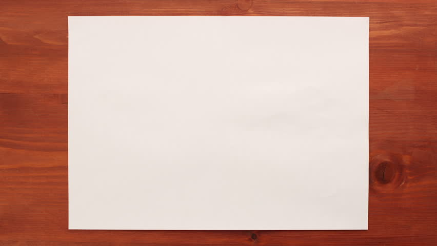 Crumpling white sheet of paper on wooden background - stop motion animation