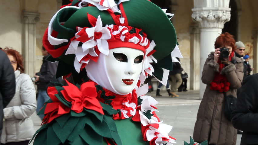 VENICE - MARCH 6: Unidentified person in carnival costume poses at Venice carnival on March 6, 2011.The Venice Carnival is the most internationally known festival celebrated in Venice, Italy, as well as being one of the oldest.