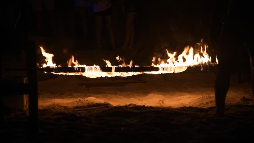 Dancing Fire Limbo at Beach in night   Shutterstock HD Video #10707668