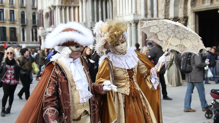 VENICE - MARCH 6: Unidentified people in carnival costumes pose at Venice carnival on March 6, 2011.The Venice Carnival is the most internationally known festival celebrated in Venice, Italy, as well as being one of the oldest.