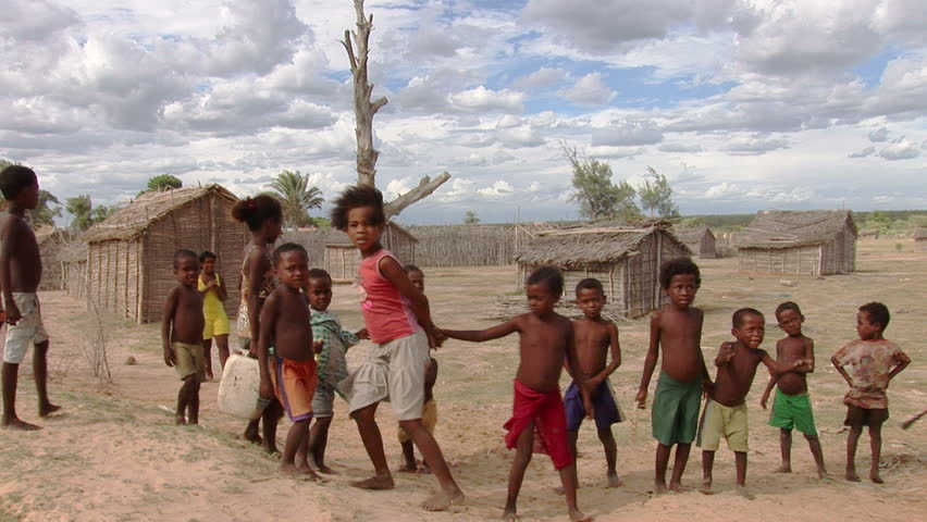 TULEAR/MADAGASCAR 7TH MARCH 2010 -Children smile to camera in a remote fishing village in the south of Madagascar