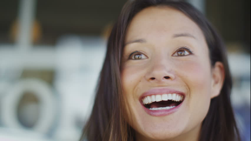 4K Attractive young woman talking cheerfully to someone off camera in a public setting, shot on RED EPIC | Shutterstock HD Video #10725554