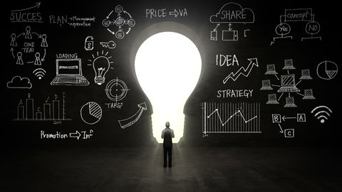 businessman Standing in front of black, shape of bulb light, Business plan and various graph in black wall concept.