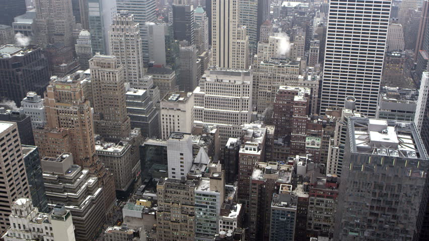 Manhattan, New York - March, 2015: Static view looking down from rooftop to the buildings below in Manhattan. | Shutterstock HD Video #10770743