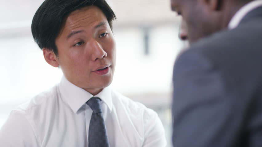 4k, Young executive in a meeting with his manager | Shutterstock HD Video #10779533