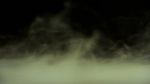 Heavy smoke moving near the ground.