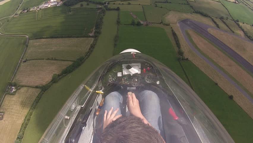 Glider / sailplane  aerobatics over English countryside