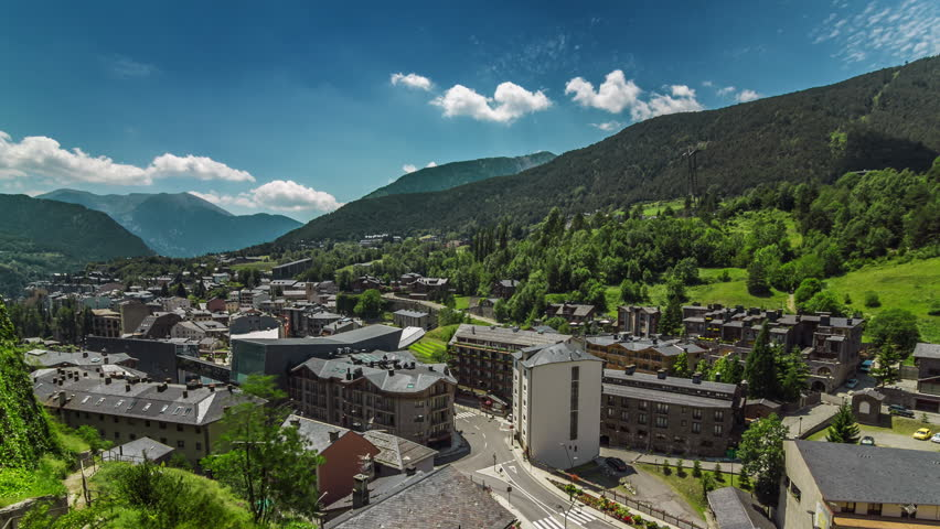 Aerial panoramic timelapse (time lapse, time-lapse) of small cozy european town of La Massana among the mountains of Andorra.