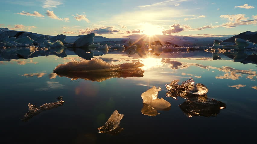Icebergs Lighting up like Crystals During Sunrise in Glacier Lagoon. Aerial Shot. Iceland. | Shutterstock Video #10811123