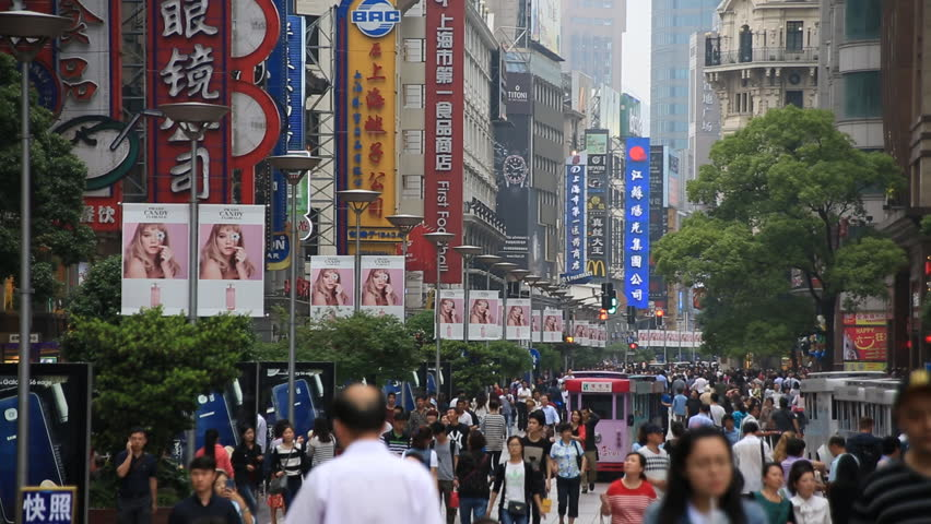 SHANGHAI, CHINA - CIRCA JUNE 2015 : Crowded visitors and travelers walking at Shanghai Nanjing Road in Shanghai, China. 