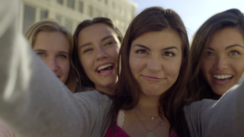 Teenage Girls Take Selfies Together, Girl Swipes Through Photos On Her Phone, Does A Little Happy Dance (4K) | Shutterstock HD Video #10819868