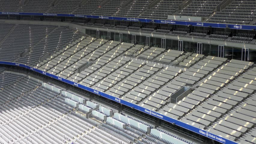 MUNICH, GERMANY - JUNE 28: Allianz Arena football stadium on June 28, 2015 in Munich, Germany. The stadium has capacity for almost 70.000 spectators, making it the third largest stadium in Germany. | Shutterstock HD Video #10872473