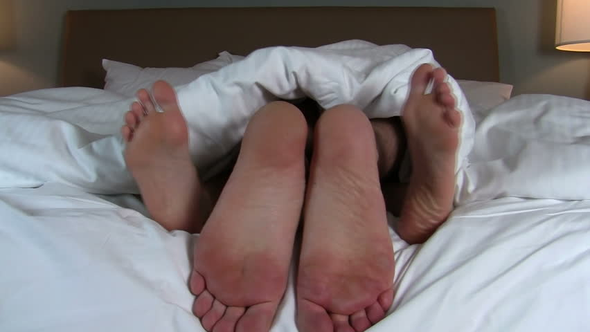 Naughty couple in bed close- up of feet - HD