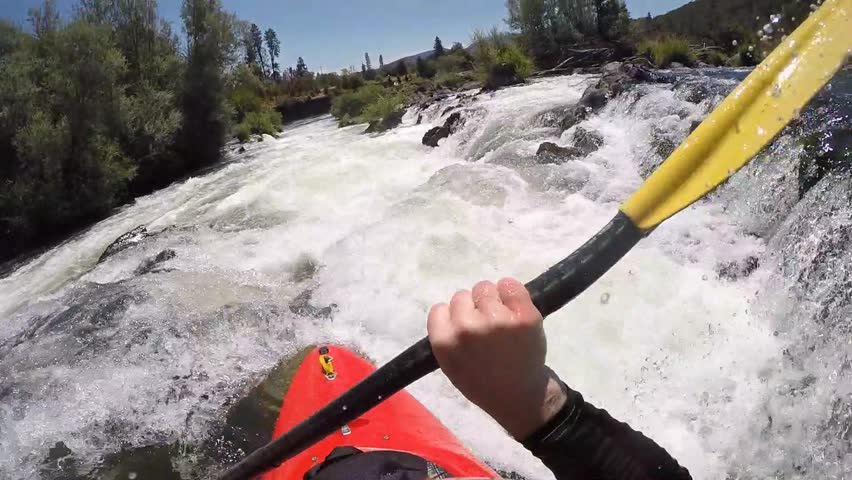 Whitewater kayak running class IV Powerhouse Rapid on the Rogue River in southern Oregon. POV