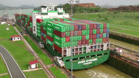 PANAMA CITY - JUNE 2015 - Ships, cargo container, boats, vessels, freighters during transit through Panama Canal at Miraflores Locks. Global ocean shipping, worldwide commerce, logistics, sea industry