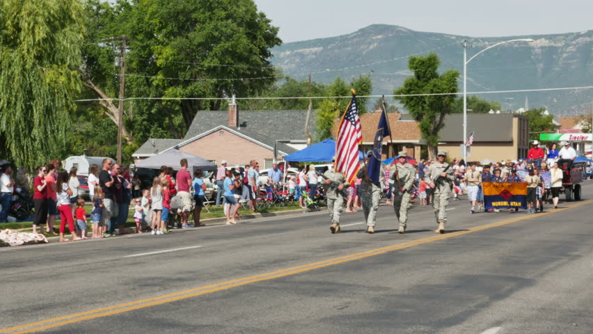 MORONI, UTAH - JULY 4TH 2015: Members of the Utah National Guard parade the US Flag and the Utah state flag during the annual Fourth of July parade in a small rural town.