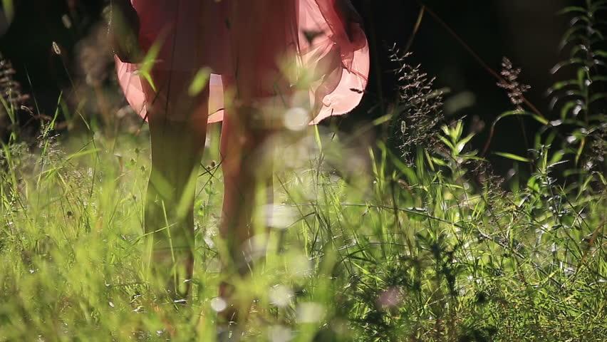 Girl Wearing Light Summer Dress Walking in the Field on Sunny Day Outdoors | Shutterstock HD Video #10958393
