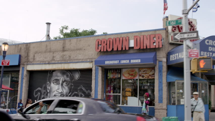NEW YORK - JULY 12, 2015: Yankee legends, murals on storefronts, Crown Diner, in the Bronx en route to Yankee Stadium, 4K, NY. The Bronx is the northernmost borough of NYC.