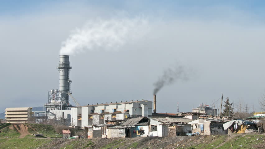 smoking factory chimneys surrounded by poverty. HD