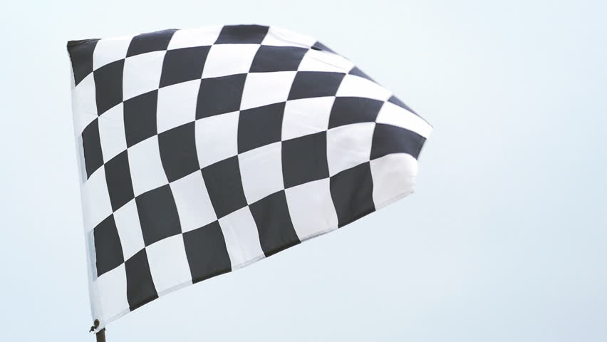 Checkered race flag waving in slow motion at finish line