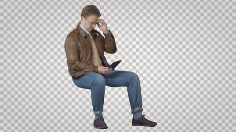 Man sitting with PC tablet. Green screen footage. File format - .mov. Codec - PNG+Alpha. Combine these footage with your background or other people