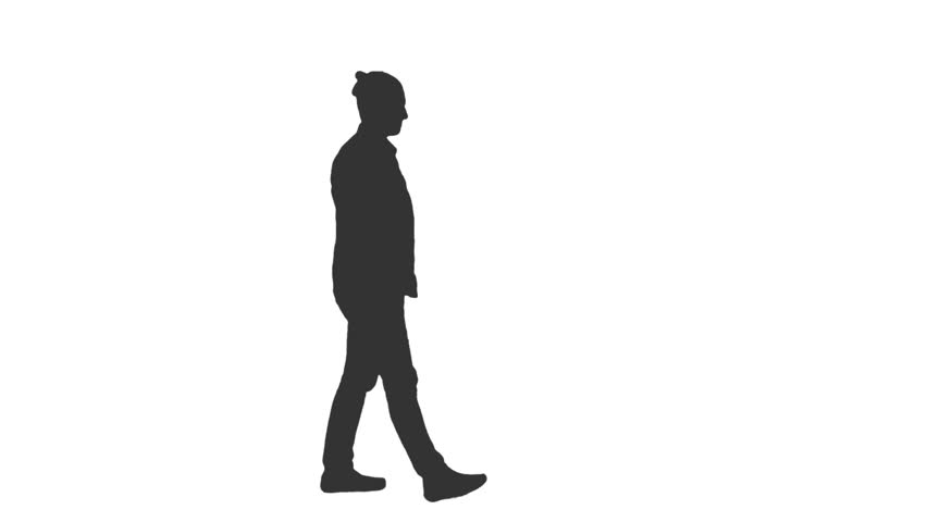 silhouette of a young man walking with a guitar side view