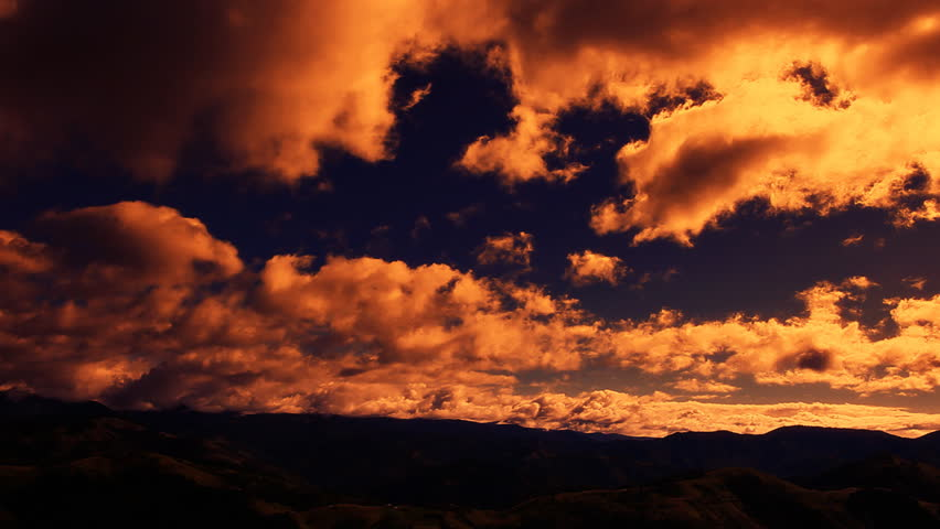 Sunset clouds above mountain peaks
