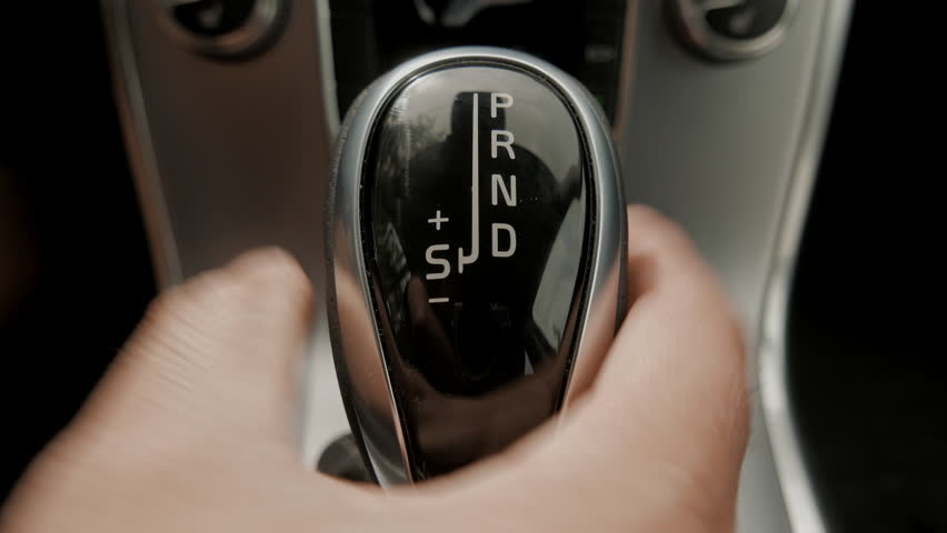 Automatic transmission, automatic gear shift, is moved from P (Park) to D (Drive) and back. Car start, starting a modern car.