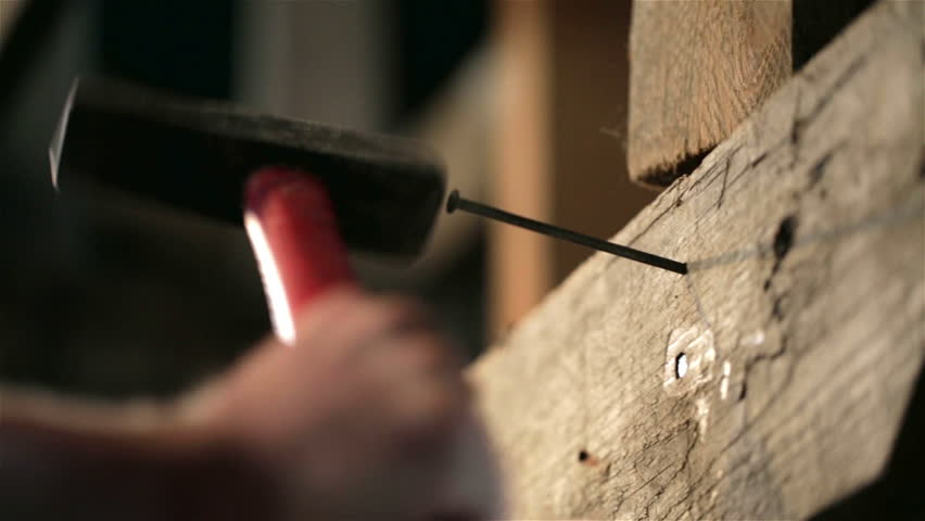 Detail of worker with a nail and a hammer | Shutterstock HD Video #11123435
