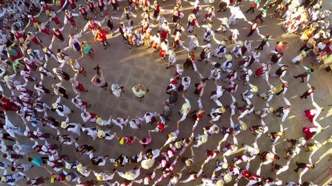 TULCEA, ROMANIA - AUGUST 08: Friendship dance (aerial view) at the International Folklore Festival on August 08, 2015 in Tulcea, Romania.