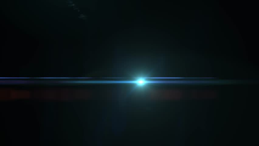 Fancy Light Effects In A Dark Background Stock Footage: Optical Lightinglight Flare On A Stock Footage Video (100