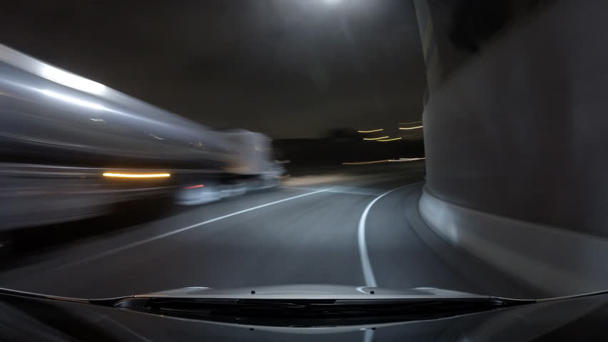 Night driving time lapse with hood reflection on the foggy Harbor 110 Freeway in downtown Los Angeles.   Shutterstock HD Video #11171516