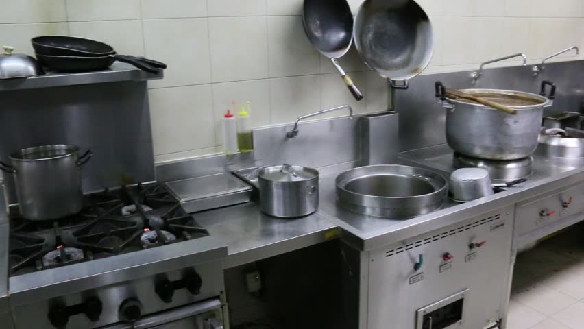 Restaurant Kitchen Video work cook in a restaurant kitchen stock footage video 8521333