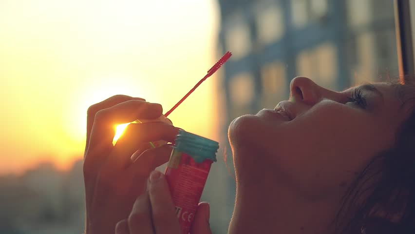 Slow motion of smiles young beautiful happy woman blowing bubble at sunset city 1920x1080 | Shutterstock HD Video #11194187