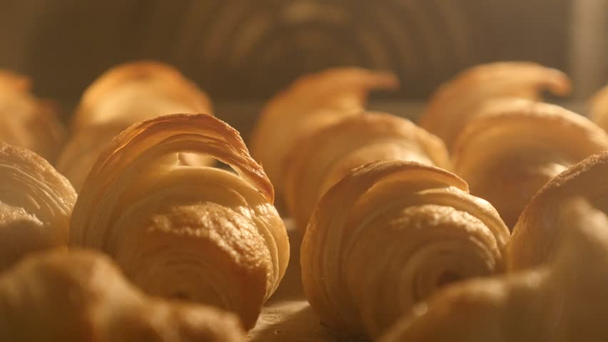 Dough made rolls baking in the oven close-up tilt 4K 2160p 30fps UltraHD footage - Slow tilting on crescent roll pastry bake 4K 3840X2160 UHD video