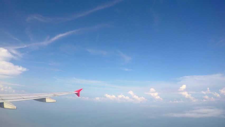 Flying Aircraft Wing through the Clouds and Blue Sky. Timelapse. HD, 1920x1080. #11210192