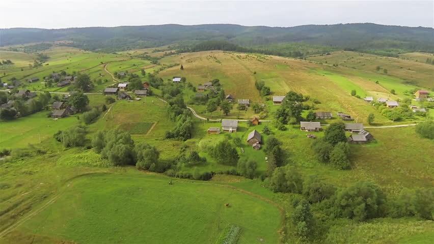 Village at Ukrainian Carpathians mountains. Aerial shot - HD stock footage clip