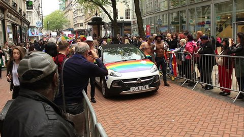 Birmingham Gay Pride 2015, England - semi naked, muscular guys with a rainbow wings