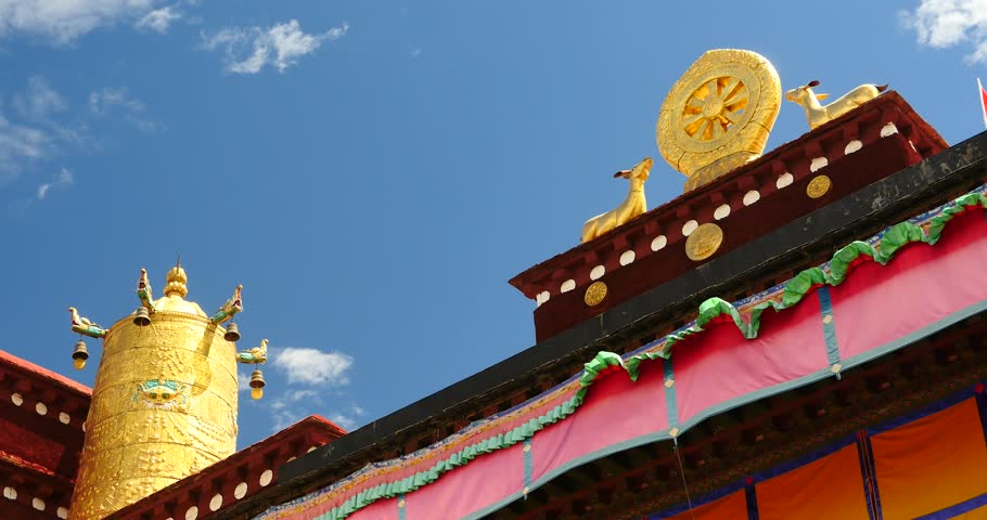 4k closeup of The Jokhang Temple In Lhasa,Tibet,white clouds in blue sky. gh2_09658_4k