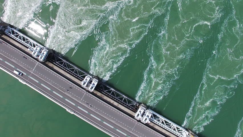 2016 Aerial Video (Ultra HD) of the famous Dutch Delta Works. Sunny weather. Opened barriers while traffic passing by. 90 degrees Angle with rotation only.