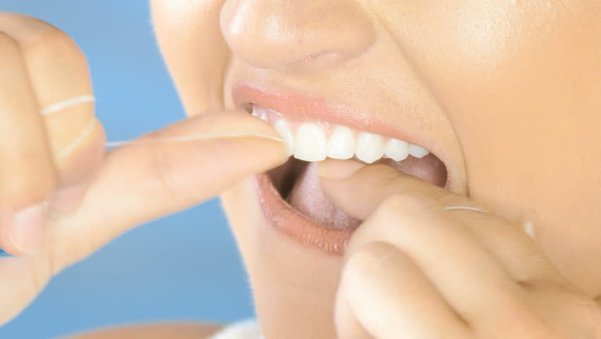 Dental floss, beautiful woman flossing teeth smiling closeup