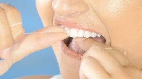 Dental floss, beautiful woman flossing teeth smiling closeup