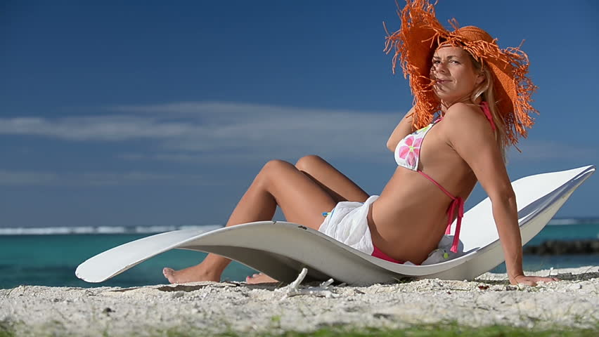 Sunbathing Woman On Mauritius Beach Lying On A Reclining